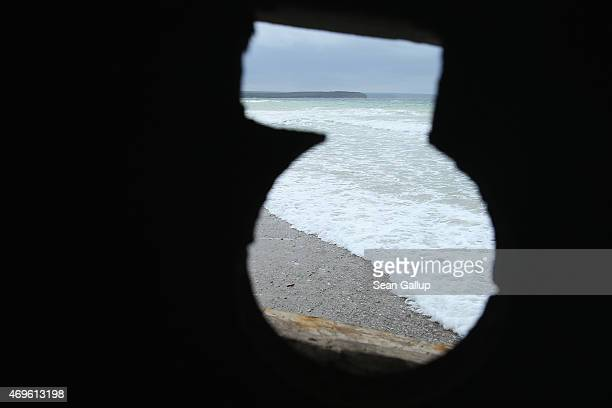 An original Turkish machine gunner's concrete post from the Gallipoli campaign affords a narrow view onto the beach near Anzac Cove on April 6, 2015...