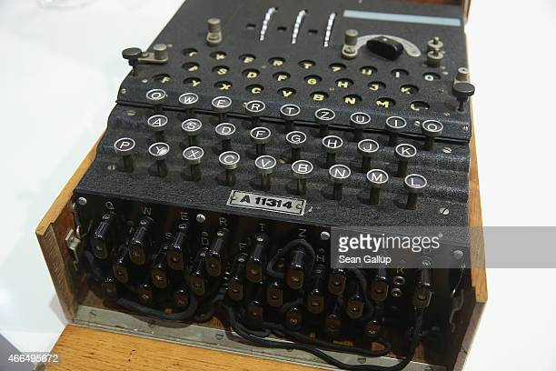 An original World War II Enigma coding machine stands on display at the stand of the German Federal Intelligence Service at the 2015 CeBIT technology...