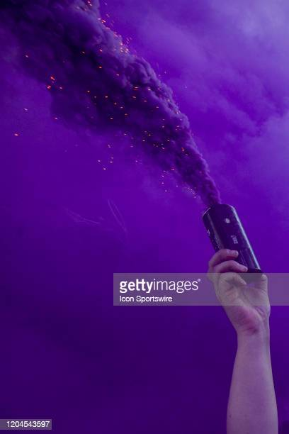 An Orlando fan holds a smoke bomb before the soccer match between Real Salt Lake and Orlando City SC on February 29 at Exploria Stadium in Orlando FL