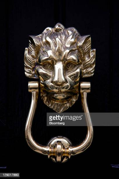 An ornamental door knocker in the shape of a lion's head sits on the front door of a residential property in Mayfair London UK on Monday Oct 10 2011...