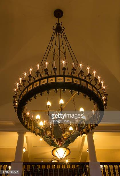 An ornate chandelier hangs in the lobby of the Fairmont Chateau Lake Louise hotel on June 26 2013 in Lake Louise Alberta Canada Major flooding along...
