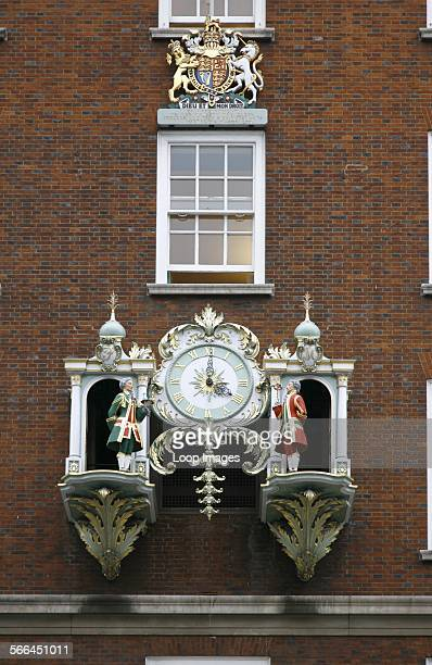 An ornate clock on the front of the Fortnum and Mason department store on Piccadilly