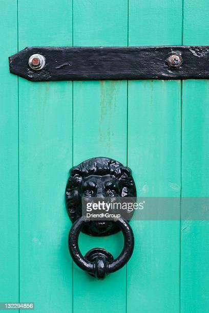 an ornate door knocker. - door knocker stock photos and pictures