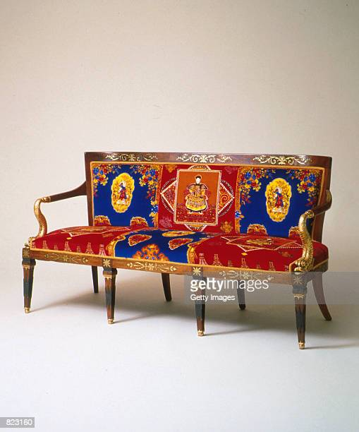 An ornate piece of furniture from the Miami home of murdered designer Gianni Versace Sotheby's is auctioning the collection of Versace's furnishings...