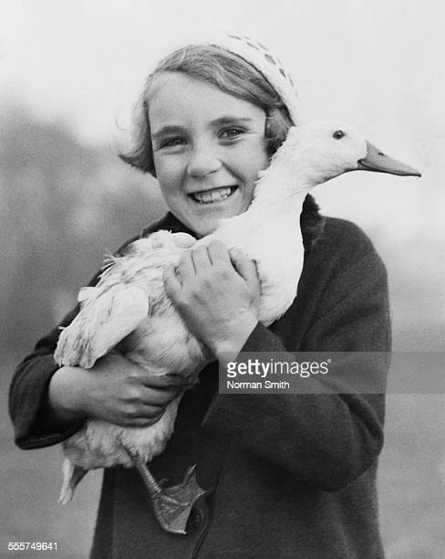 An orphan from the National Children's Home and Orphanage in Gosport, Hampshire, holding a tame duck at the Institution's farm, Alverstoke Farm,...