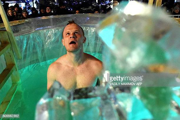 An Orthodox believer dips into the icy waters on January 18 2016 during the celebration of the Epiphany holiday in central Moscow Among Orthodox...