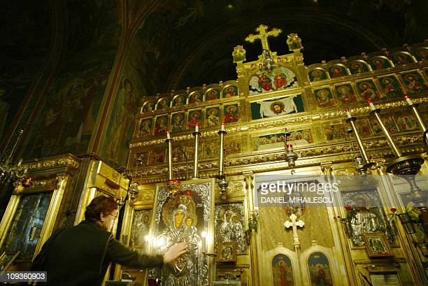 An orthodox believer touches the icon of The Virgin Mary at Saint Basil and Saint Parascheva basilica in Bucharest 19 January 2005 Adriana Iliescu...
