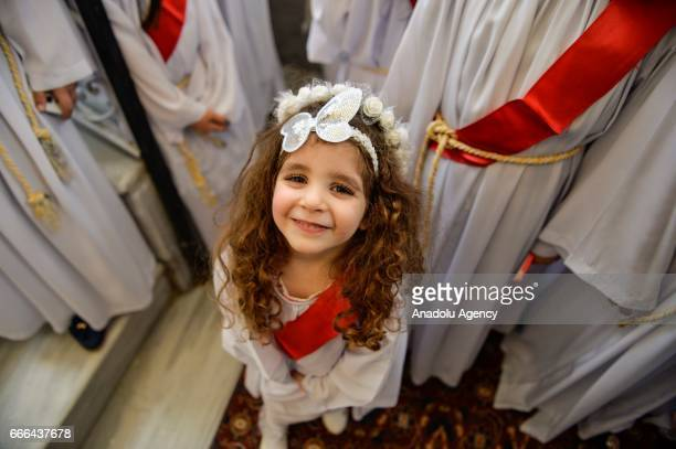 An Orthodox Christian kid attends the Palm Sunday celebrations at StPorphyrios Church in Gaza City Gaza on April 09 2016 Palm Sunday is celebrated on...