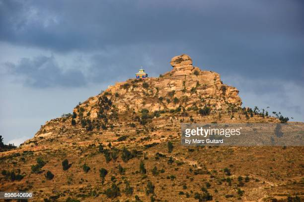 an orthodox church perched on a rocky outcrop near hawzen, tigray, ethiopia - ethiopian orthodox church stock pictures, royalty-free photos & images