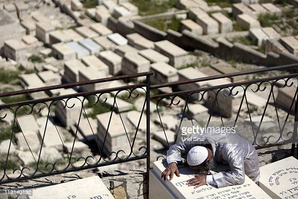 An Orthodox Jew mourns during the funeral of Ben-Yosef Livnat at the Mount of Olives cemetery on April 24 in east Jerusalem, Israel. Livnat was shot...