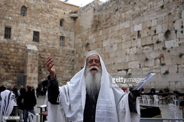An Orthodox Jewish man chants slogans against members of the liberal religious group Women of the Wall as they pray at the Western Wall in...
