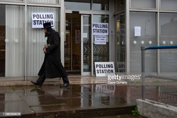 An Orthodox Jewish man leaves a polling station after voting in the General Election in Stamford Hill London United Kingdom on 12th December 2019