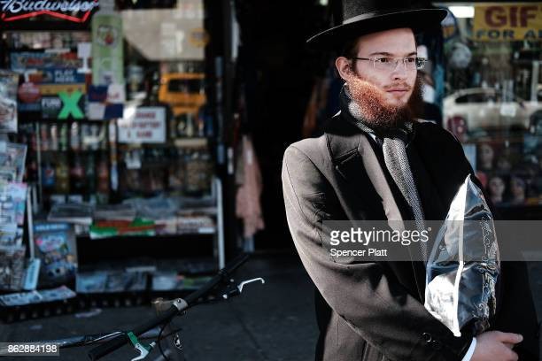 An Orthodox Jewish man stands on a corner of Coney Island Avenue on October 18 2017 in New York City Coney Island Avenue a road that runs northsouth...