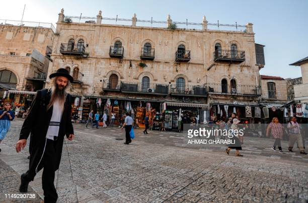 An Orthodox Jewish man walks past the Petra hostel in the Old City of Jerusalem near the Jaffa Gate on June 11, 2019. - Israel's top court gave final...