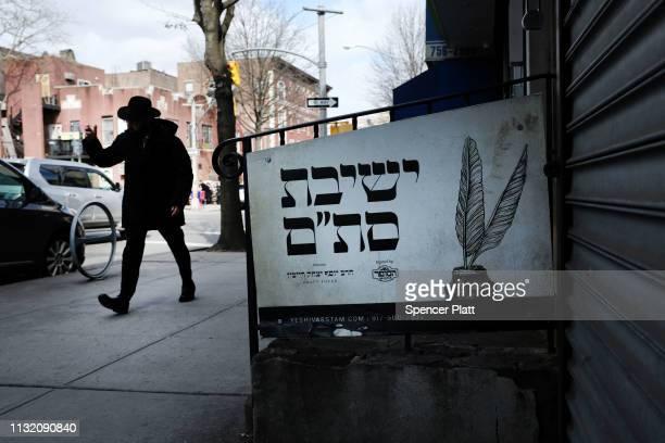 An Orthodox Jewish man walks through the neighborhood of Crown Heights on February 25 2019 in New York City The historic Brooklyn neighborhood has...