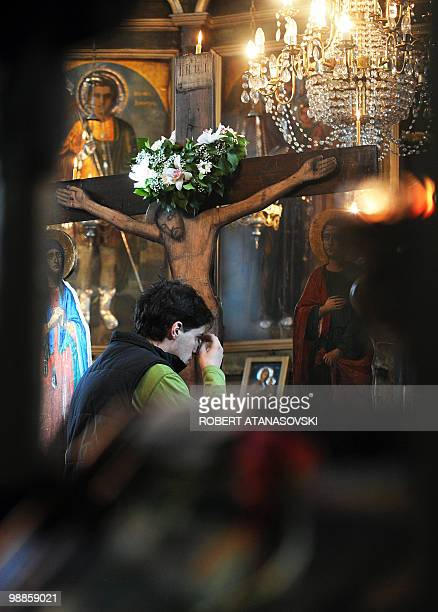 An Orthodox man crosses himself at the St Dimitri Church in Skopje during the Good Friday processions on April 2 2010 The Orthodox believers in...
