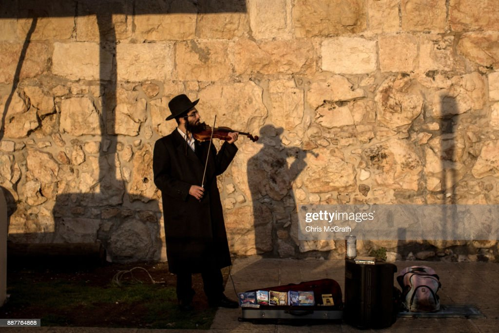 An Orthodox man plays violin outside the Jaffa Gate in the Old City on December 7, 2017 in Jerusalem, Israel. Tension is high in Jerusalem a day after U.S President Donald Trump's announcement recognizing Jerusalem as the capital of Israel. President Trump went ahead with the announcement despite warnings from Middle East leaders and the Pope condemning the decision. Clashes between Israeli forces and Palestinian protesters erupted in several West Bank cities.