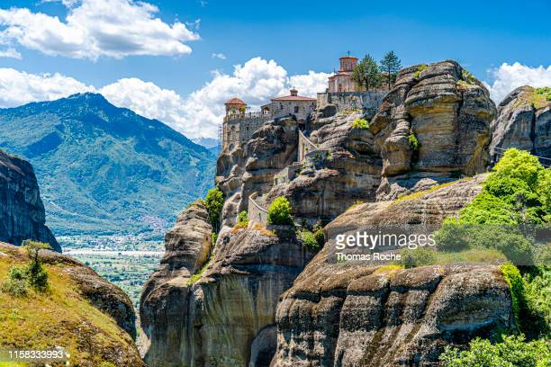 an orthodox monastery in the meteora rock formation - meteora stock pictures, royalty-free photos & images