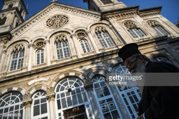 An Orthodox official is seen outside the Hagia Triada Greek Orthodox church on September 1, 2018 in Istanbul, before the meeting of the Hierarchy of...