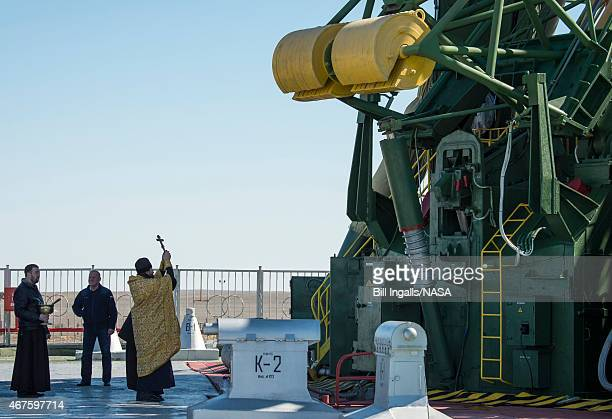 An Orthodox Priest blesses the Soyuz rocket at the Baikonur Cosmodrome Launch pad March 26 2015 at the Baikonur Cosmodrome in Kazakhstan NASA...