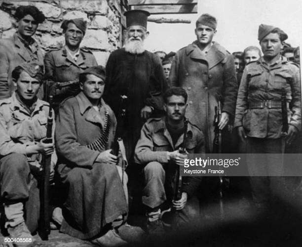 An Orthodox priest with partisans fighting to liberate Greece in 1939 from German occupation during the second world war, 1939 in Greece.