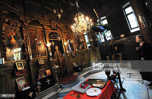 An Orthodox woman crosses herself at the St Dimitri Church in Skopje during the Good Friday processions on April 17 2009 The Orthodox believers in...