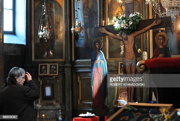 An Orthodox woman crosses herself at the St Dimitri Church in Skopje during the Good Friday processions on April 2 2010 The Orthodox believers in...