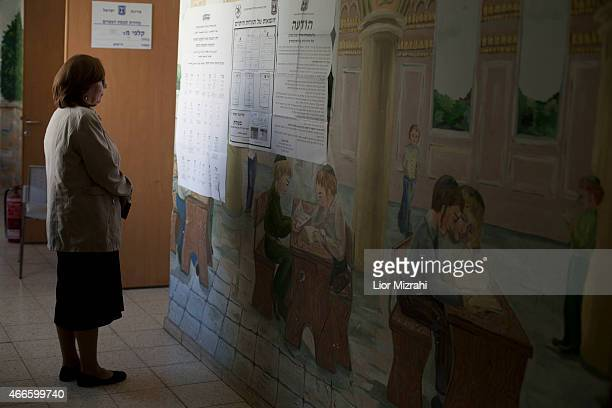 An Orthodox woman stands outside a polling station on election day on March 17 2015 in Kiryat Ye'arim Israel Israel's general election voting has...