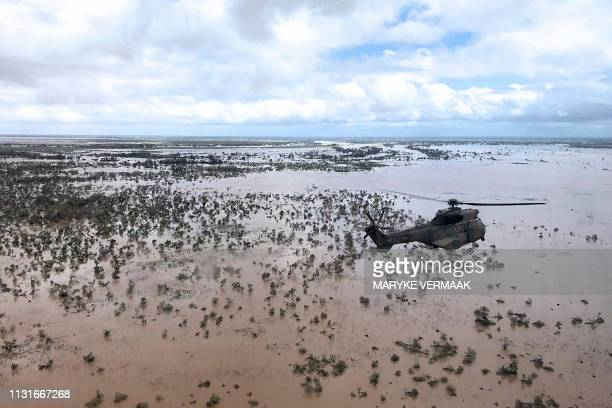 An Oryx helicopter from the SANDF flies during an air relief drop mission over the flooded area around Beira, central Mozambique, on March 20, 2019....