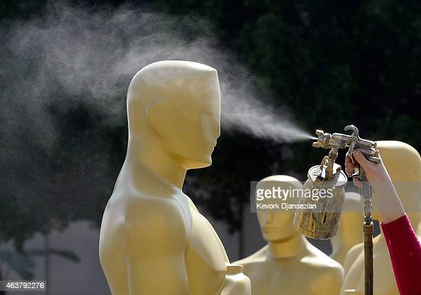 An Oscar statue gets dusting of gold paint during preparation of 87th Annual Academy Awards at Dolby Theater February 18 2015 in Hollywood California