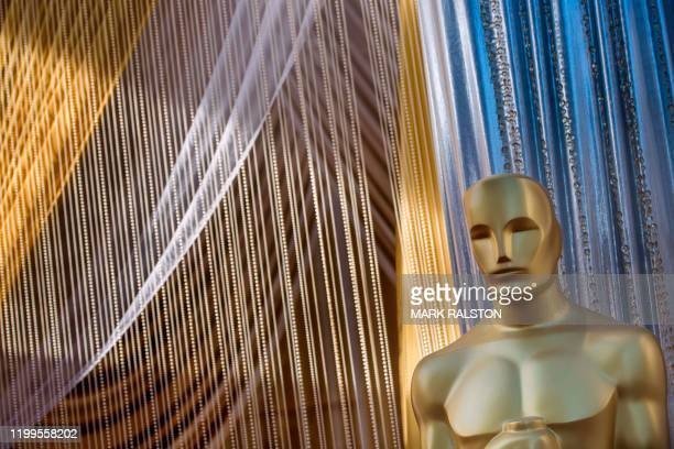 TOPSHOT An Oscars statue is displayed on the red carpet area on the eve of the 92nd Oscars ceremony at the Dolby Theatre in Hollywood California on...