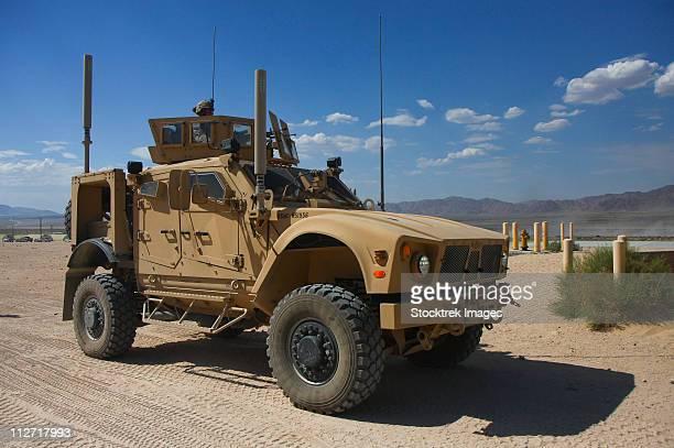 an oshkosh m-atv mine resistant ambush protected vehicle. - mine resistant ambush protected stock pictures, royalty-free photos & images