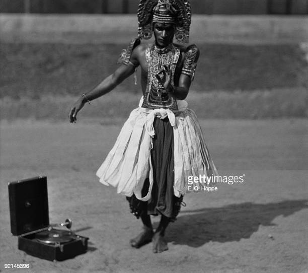 An Ottan Thullal Dancer dancing to gramophone music in Trivandrum Kerala India 1929