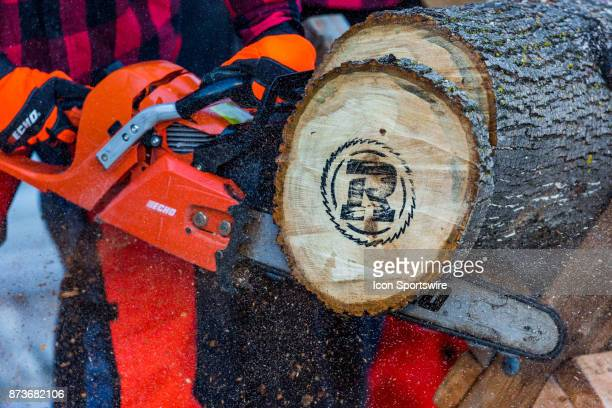 An Ottawa RedBlacks wood cookie is cut from the touchdown log after a RedBlacks touchdown during Canadian Football League Eastern SemiFinal playoff...