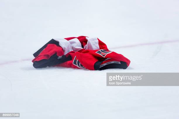 An Ottawa Senators jersey lays on the ice after a frustrated fan threw there after National Hockey League action between the Boston Bruins and Ottawa...