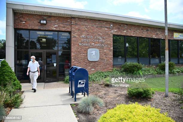 An ouside view of a post office in Morris Plains, New Jersey. Postmaster General Louis DeJoy has accepted House Democrats' request to come before...