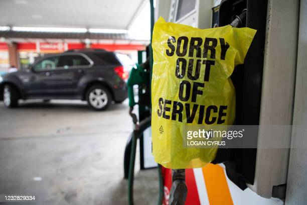 """An """"Out Of Service"""" bag covers a gas pump as cars continue line up for the chance to fill their gas tanks at a Circle K near uptown Charlotte, North..."""