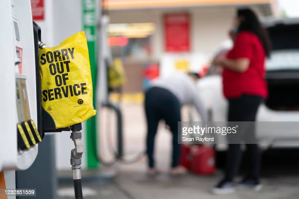 An out of service bag covers a pump handle at a gas station May 12, 2021 in Fayetteville, North Carolina. Most stations in the area along I-95 are...