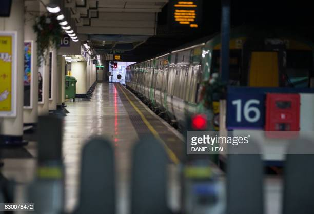 An out of service Southern Rail train sits on a platform at Victoria station in London on December 16 2016 Hundreds of thousands of commuters were...