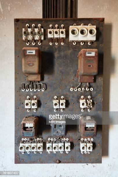 An outdated circuit board in an abandoned derelict building.