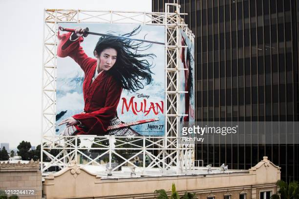 "An outdoor ad for Disney's ""Mulan"" is seen on March 13, 2020 in Hollywood, California. The spread of COVID-19 has negatively affected a wide range of..."