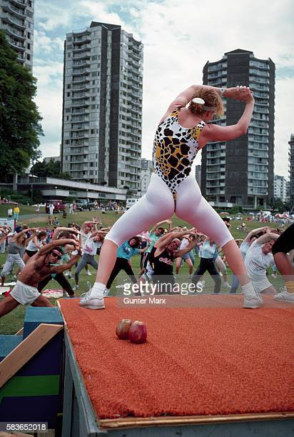 An outdoor aerobics class takes place in parklands in downtown Vancouver British Columbia Canada