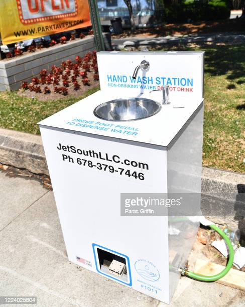 An outdoor hand wash station is seen at the entrance of the Atlanta Beltline as the coronavirus pandemic continues on May 10 2020 in Atlanta Georgia...