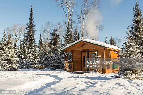 An outdoor sauna in winter