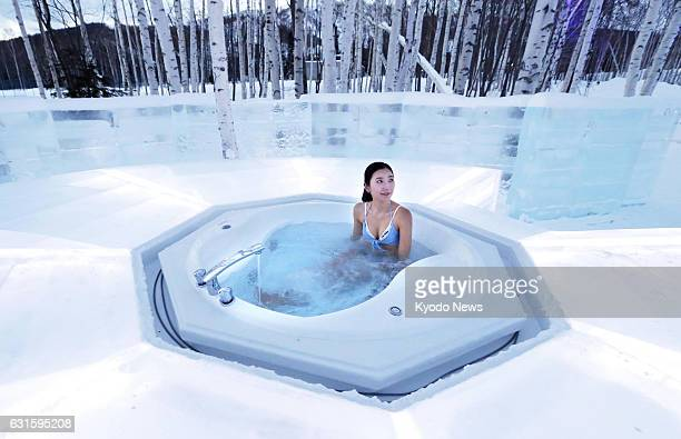 An outdoor spa bath surrounded by snowcovered birch forest is shown to the press at the Ice Village of Hoshino Resorts Tomamu in Shimukappu Hokkaido...