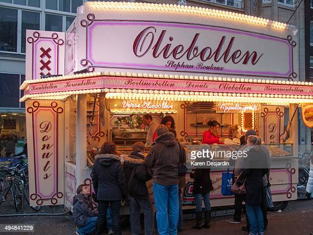 An outdoor stand in central Amsterdam selling oliebollen a snack similar to a donut but without a hole in the center Oliebollen are a traditional New...