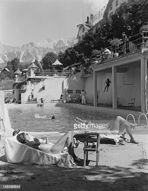 An outdoor swimming pool in the Alpine resort of Cortina d'Ampezzo Italy 1951