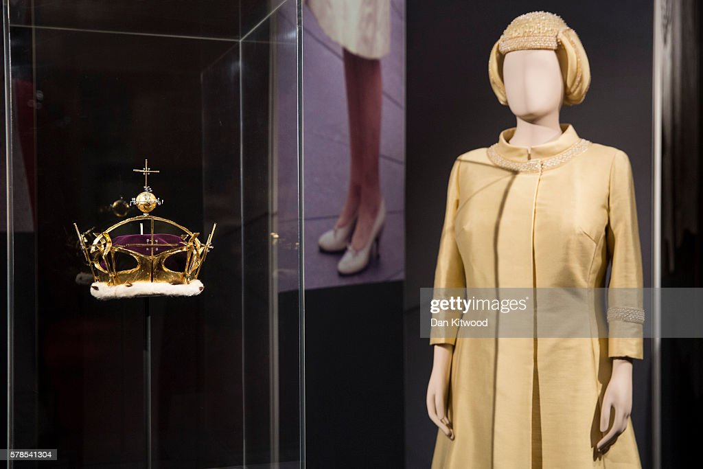 An outfit worn by Queen Elizabeth II for the investiture of Prince Charles in 1969 is displayed next to a Gold, Diamond and Platinum Corenet worn on the same occasion during a photocall at Buckingham Palace on July 21, 2016 in London, England. The piece makes up part of a forthcoming exhibit 'Fashioning a Reign: 90 Years of Style from The Queen's Wardrobe' to coincide with the Summer Opening of Buckingham Palace. The exhibit includes outfits worn by the Queen from State events to family celebrations and runs until October 2, 2016.