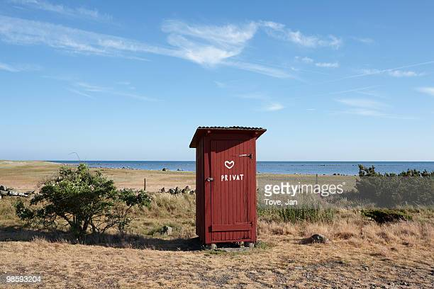 An outhouse on a beach by the sea, Sweden.