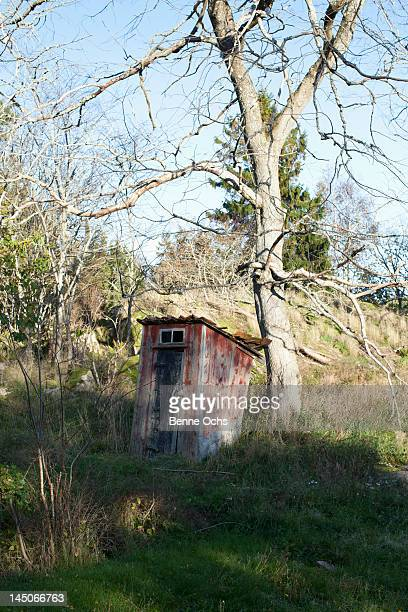 An outhouse on a hill